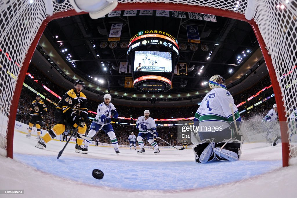 David Krejci stands by the net as Milan Lucic of the Boston Bruins scores a goal in the first period against Roberto Luongo of the Vancouver Canucks...