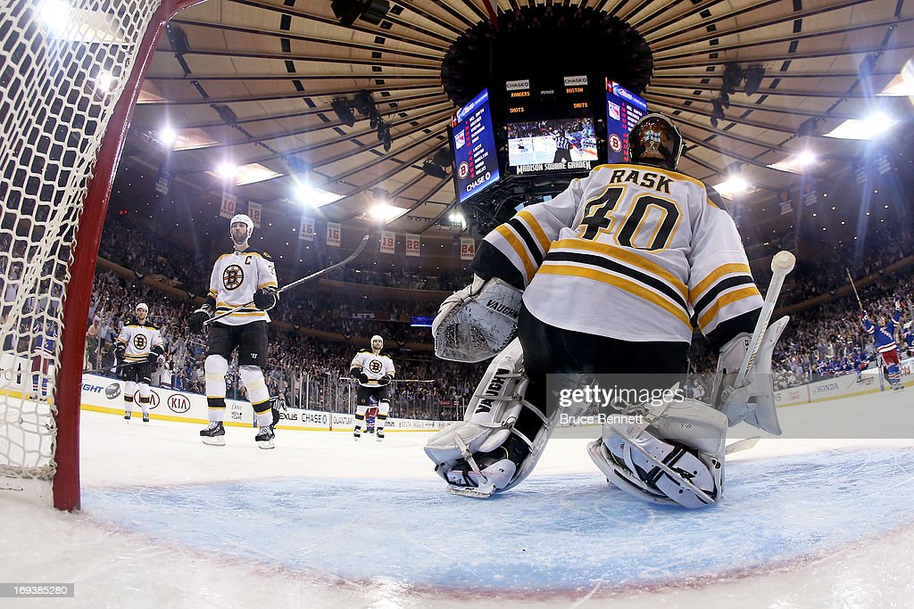 <a gi-track='captionPersonalityLinkClicked' href=/galleries/search?phrase=David+Krejci&family=editorial&specificpeople=722556 ng-click='$event.stopPropagation()'>David Krejci</a> #46, <a gi-track='captionPersonalityLinkClicked' href=/galleries/search?phrase=Zdeno+Chara&family=editorial&specificpeople=203177 ng-click='$event.stopPropagation()'>Zdeno Chara</a> #33, Torey Krug #47 and goalie <a gi-track='captionPersonalityLinkClicked' href=/galleries/search?phrase=Tuukka+Rask&family=editorial&specificpeople=716723 ng-click='$event.stopPropagation()'>Tuukka Rask</a> #40 of the Boston Bruins look on dejected as the New York Rangers celebrate their 4-3 overtime victory on the game-winning goal by Chris Kreider #20 (not pictured) in Game Four of the Eastern Conference Semifinals during the 2013 NHL Stanley Cup Playoffs at Madison Square Garden on May 23, 2013 in New York City.
