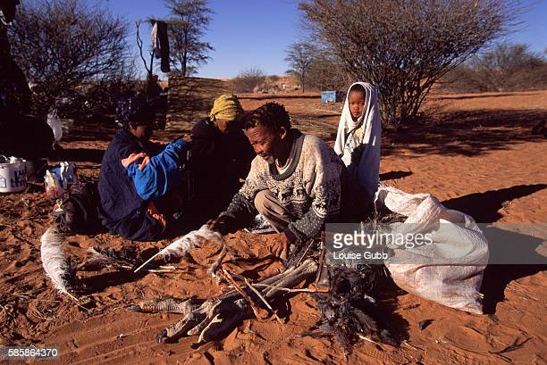 David Kruiper traditional leader of the iKhomani San Bushmen of the Kalahari sorts his bag of ostrich parts which he and his family make crafts from...