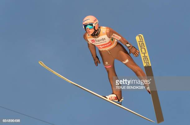 David Kubacki from Poland soars during the FIS Ski Jumping World Cup Men´s Team HS225 in Vikersund on March 18 2017 / AFP PHOTO / NTB Scanpix / Terje...