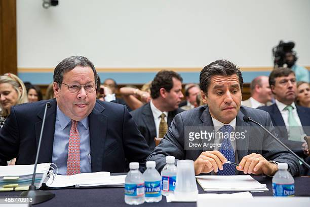David L Cohen Executive Vice President of Comcast and Robert D Marcus Chairman and CEO of Time Warner Cable prepare for the start of a House...