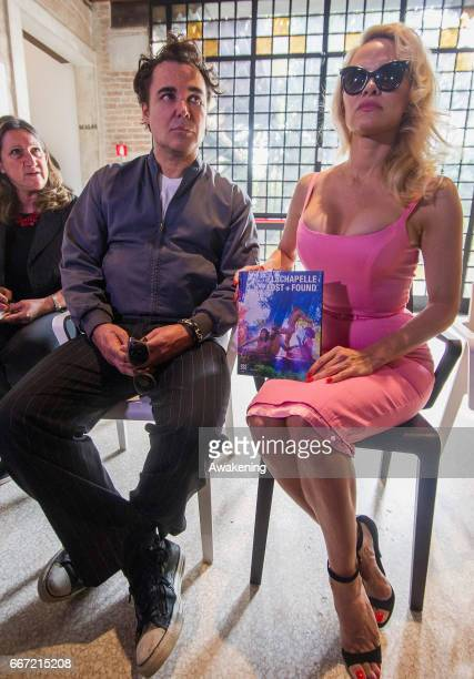 David La Chapelle and Pamela Anderson speak during a press preview for 'David LaChapelle Lost Found' at the Fondazione Tre Oci on April 11 2017 in...