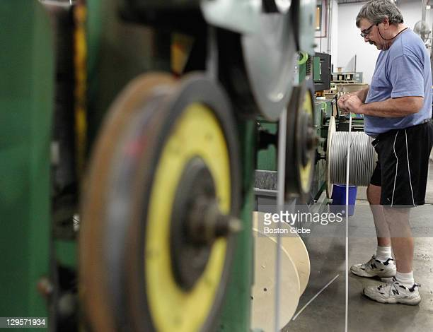 David Lambert operator manned the line of the extruder at Heat Trace Products LLC in Leominster Thursday Oct 13 2011