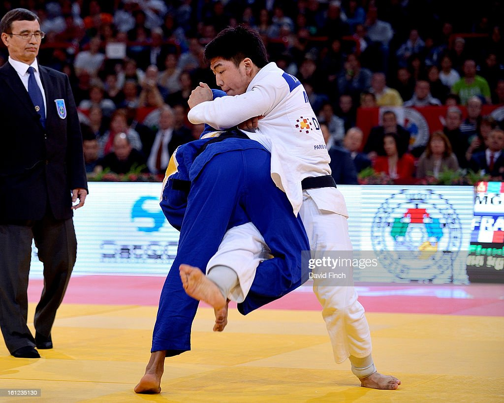 David Larose of France (blue) scored ippon (10 points) against Tumurkhuleg Davaadorj of Mongolia with this inner leg reaping throw to win the u66kgs gold medal during the Paris Grand Slam on day 1 February 09, 2013 at the Palais Omnisports de Paris, Bercy, Paris, France.