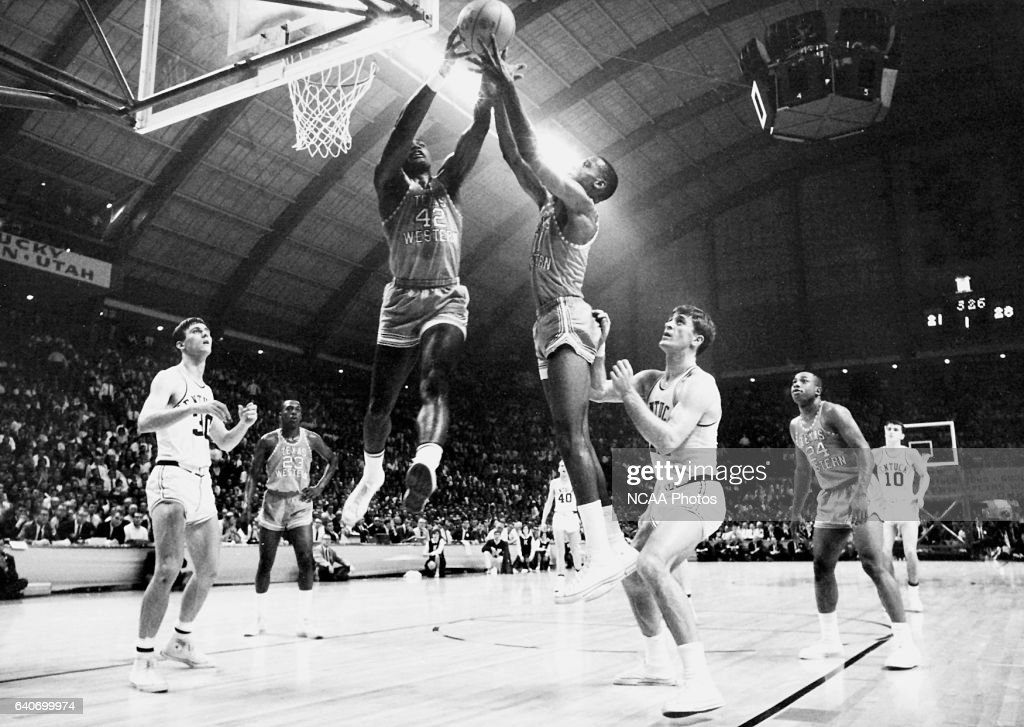 David Lattin (42) and a Texas Western teammate compete for control of a rebound as Kentucky's Tommy Kron, left, and Pat Riley , right, look on during the 1966 NCAA Championship. Texas Western defeated Kentucky 72-65 for the championship title and was the first team to have an.. all-.black starting five compete in the NCAA final. Rich Clarkson/NCAA Photos via Getty Images