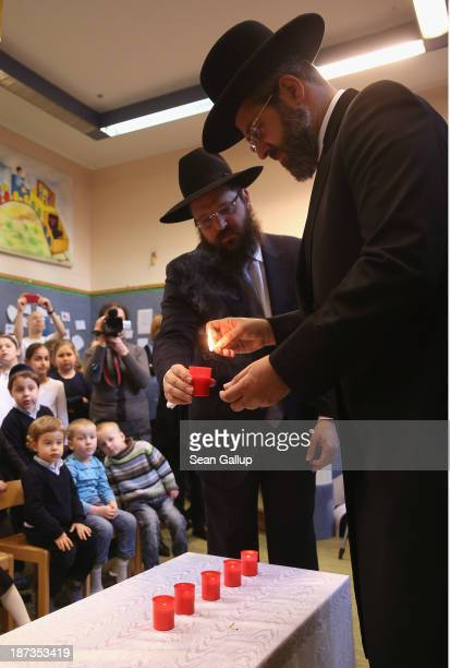 David Lau Ashkenazi Chief Rabbi of Israel lights a candle before speaking to children about the Kristallnacht pogroms at the Or Avner traditional...