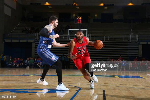 David Laury III of the Windy City Bulls against Tiago Splitter of the Delaware 87ers during the game on March 25 2017 at Bob Carpenter Center in...