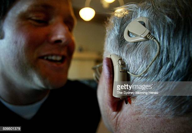 David Lawrence research assistant to Graeme Clark at the Bionic Ear Institute talks with Dennis Chards who is the recipient of a Cochlear bionic ear...