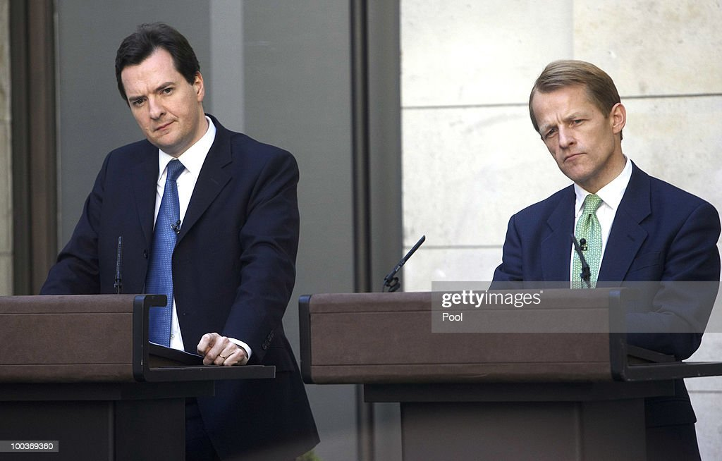 David Laws, U.K. chief treasury secretary, right, and George Osborne, U.K. chancellor of the exchequer, pause during a press conference at H.M.Treasury on May 24, 2010 in London, England. British Prime Minister David Cameron's two-week old coalition is taking its first steps to curb a record peacetime budget deficit today by announcing 6 billion pounds ($8.7 billion) of spending cuts.