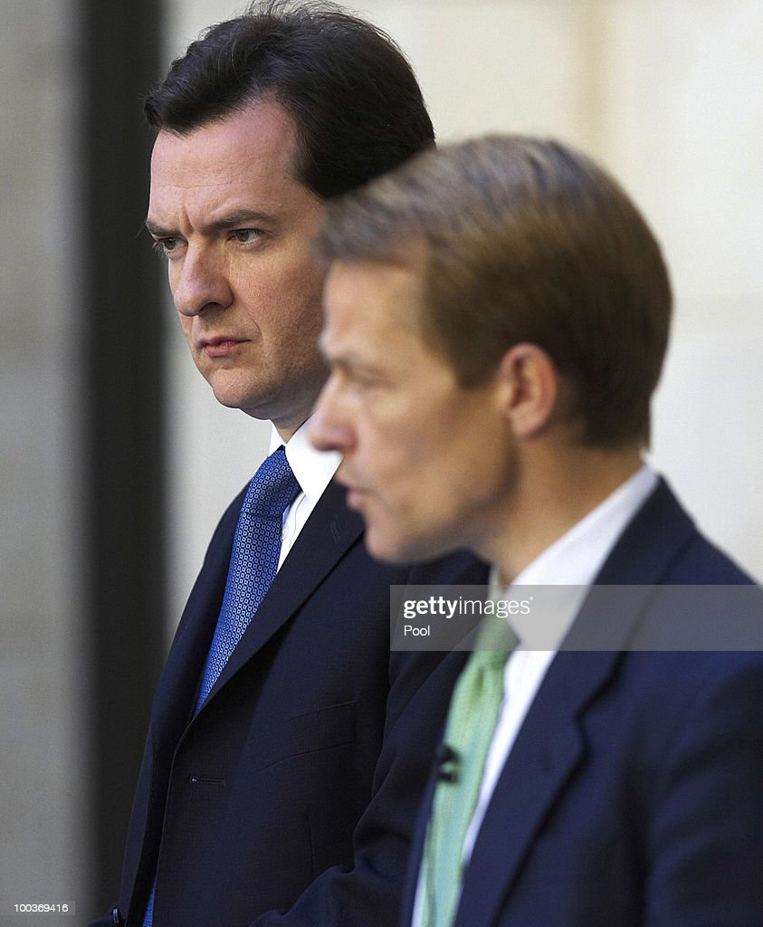 David Laws, U.K. chief treasury secretary, right, speaks as George Osborne, U.K. chancellor of the exchequer, looks on during a press conference at H.M.Treasury on May 24, 2010 in London, England. British Prime Minister David Cameron's two-week old coalition is taking its first steps to curb a record peacetime budget deficit today by announcing 6 billion pounds ($8.7 billion) of spending cuts.