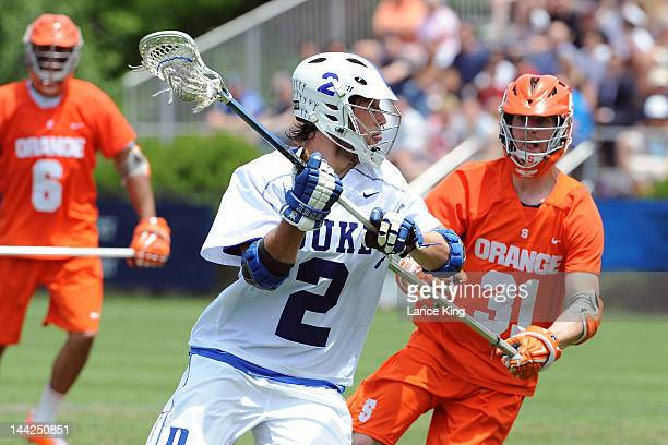 David Lawson of the Duke Blue Devils looks to pass against the Syracuse Orange during the First Round of the 2012 NCAA Men's Lacrosse Tournament at...