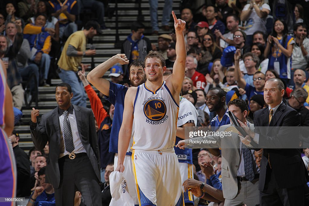 David Lee #10 and Andrew Bogut #12 of the Golden State Warriors celebrates during a game against the Phoenix Suns on February 2, 2013 at Oracle Arena in Oakland, California.