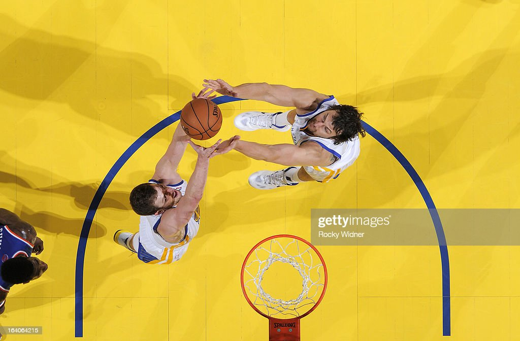 David Lee #10 and <a gi-track='captionPersonalityLinkClicked' href=/galleries/search?phrase=Andrew+Bogut&family=editorial&specificpeople=207105 ng-click='$event.stopPropagation()'>Andrew Bogut</a> #12 of the Golden State Warriors rebound against the New York Knicks on March 11, 2013 at Oracle Arena in Oakland, California.