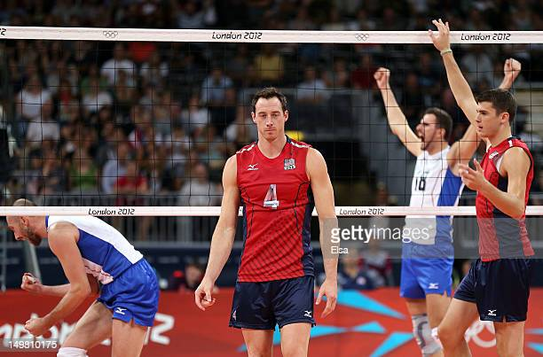 David Lee and Matthew Anderson of the United States react as Sergey Tetyukhin and Alexander Volkov of Russia celebrate the match win on Day 8 of the...