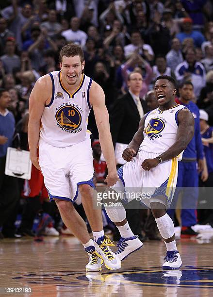 David Lee and Nate Robinson of the Golden State Warriors celebrate after Robinson made a basket in the fourth quarter of their game against the Los...
