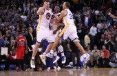 David Lee Nate Robinson and Stephen Curry of the Golden State Warriors celebrate after Robinson made a basket in the fourth quarter of their game...