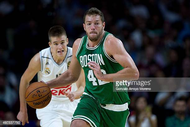 David Lee of Boston Celtics controls the ball ahead Guillermo Hernangomez of Real Madrid during the friendlies of the NBA Global Games 2015...