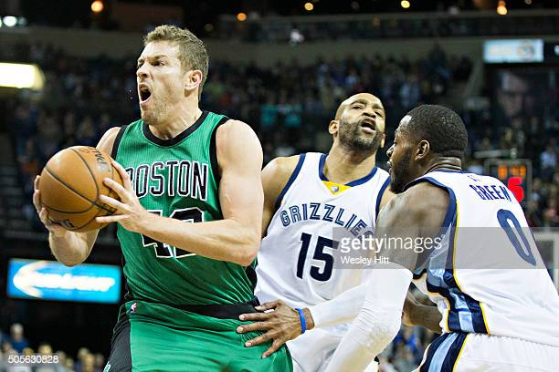 David Lee of the Boston Celtics goes strong to the basket against Vince Carter and JaMychal Green of the Memphis Grizzles at the FedExForum on...