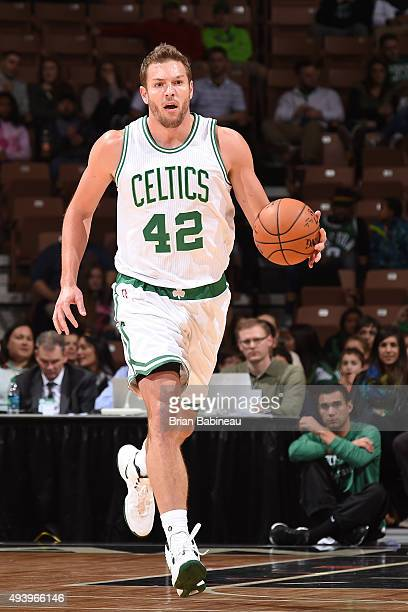David Lee of the Boston Celtics handles the ball against the Philadelphia 76ers on October 23 2015 at the Verizon Wireless Arena in Manchester New...