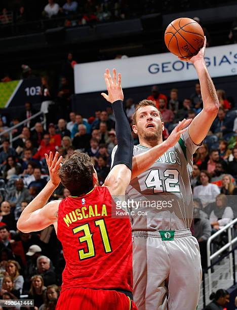 David Lee of the Boston Celtics shoots against Mike Muscala of the Atlanta Hawks at Philips Arena on November 24 2015 in Atlanta Georgia NOTE TO USER...