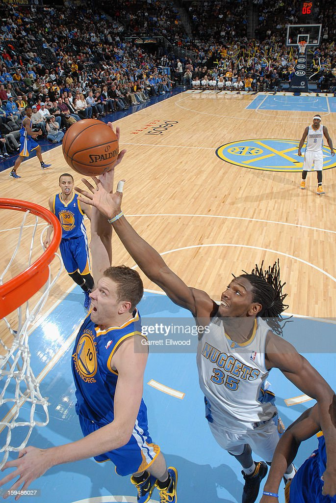 David Lee #10 of the Golden State Warriors and <a gi-track='captionPersonalityLinkClicked' href=/galleries/search?phrase=Kenneth+Faried&family=editorial&specificpeople=5765135 ng-click='$event.stopPropagation()'>Kenneth Faried</a> #35 of the Denver Nuggets fights for the rebound on January 13, 2013 at the Pepsi Center in Denver, Colorado.