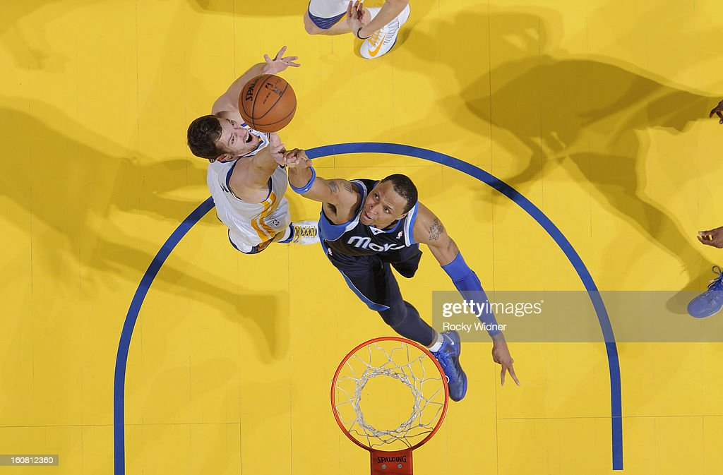 David Lee #10 of the Golden State Warriors and <a gi-track='captionPersonalityLinkClicked' href=/galleries/search?phrase=Shawn+Marion&family=editorial&specificpeople=201566 ng-click='$event.stopPropagation()'>Shawn Marion</a> #0 of the Dallas Mavericks battle for the rebound on January 31, 2013 at Oracle Arena in Oakland, California.