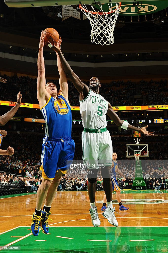 David Lee #10 of the Golden State Warriors attempts a dunk against Kevin Garnett #5 of the Boston Celtics on March 1, 2013 at the TD Garden in Boston, Massachusetts.