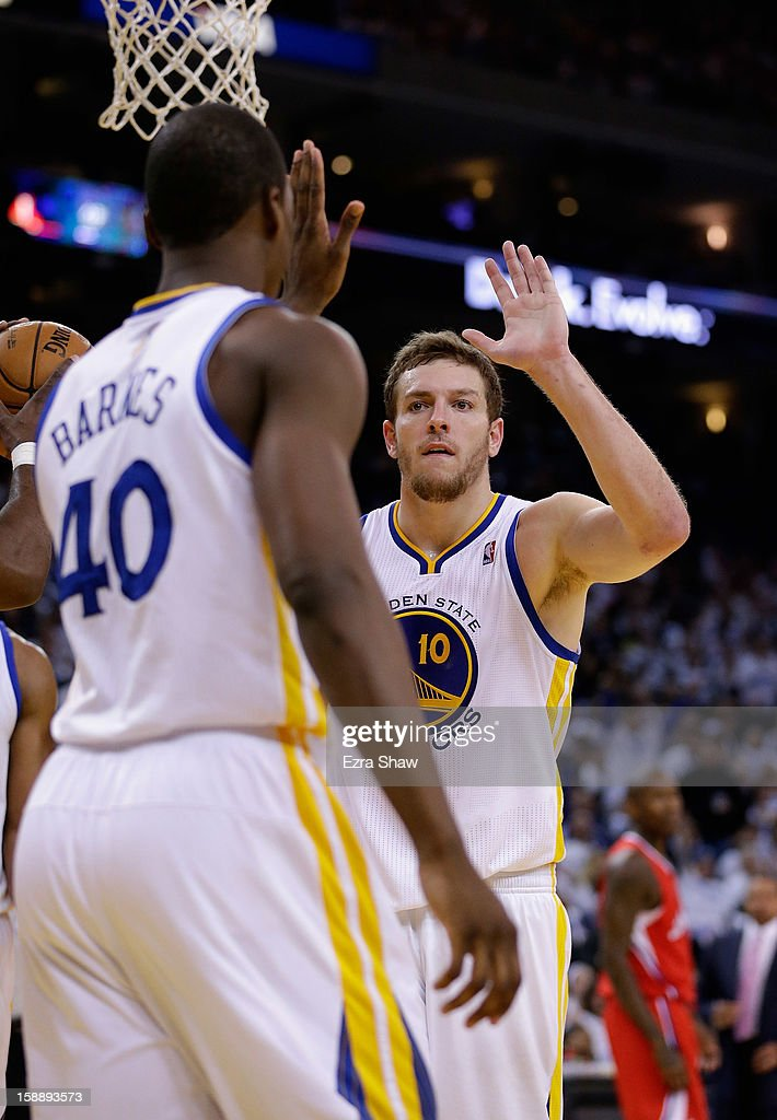 David Lee #10 of the Golden State Warriors congratulates Harrison Barnes #40 of the Golden State Warriors after Barnes made a basket against the Los Angeles Clippers at Oracle Arena on January 2, 2013 in Oakland, California.