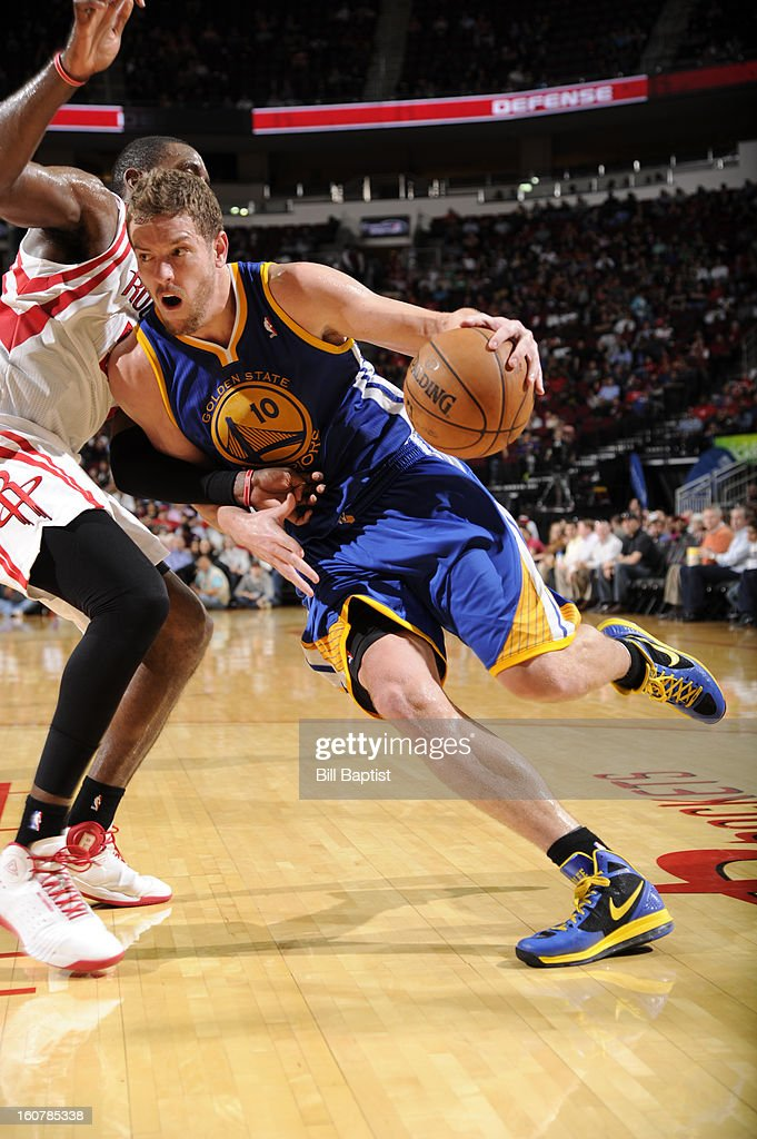 David Lee #10 of the Golden State Warriors drives against Patrick Patterson #54 of the Houston Rockets on February 5, 2013 at the Toyota Center in Houston, Texas.