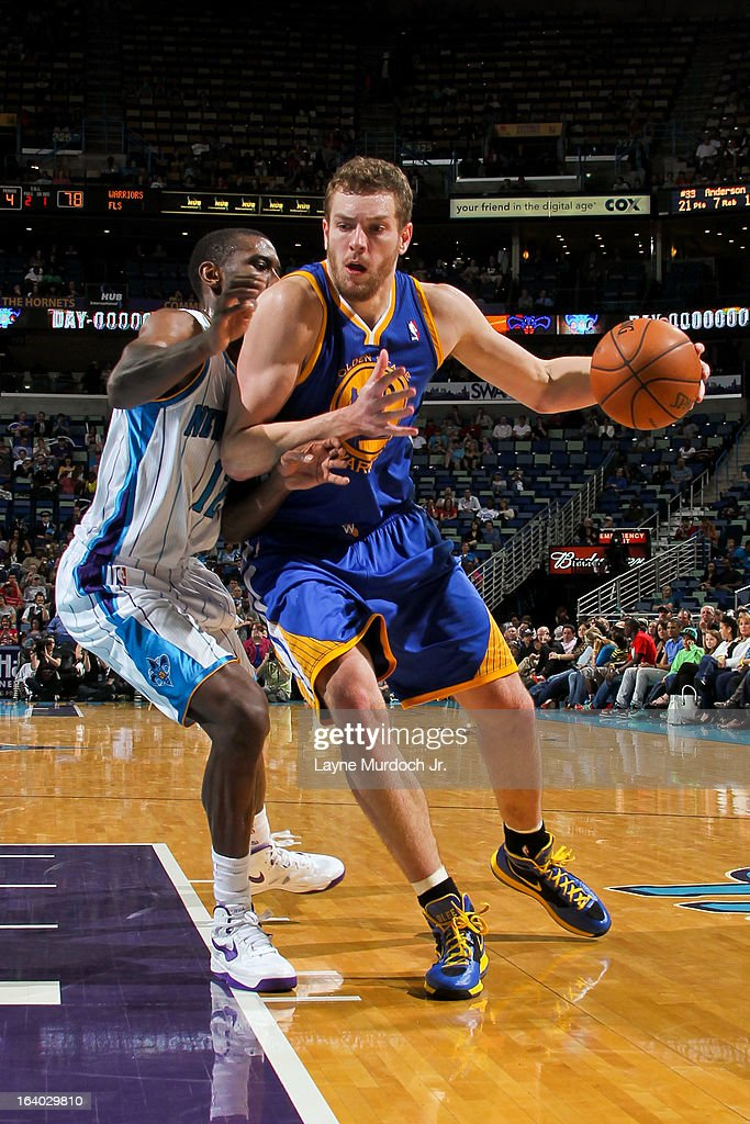 David Lee #10 of the Golden State Warriors drives against Terrel Harris #12 of the New Orleans Hornets on March 18, 2013 at the New Orleans Arena in New Orleans, Louisiana.