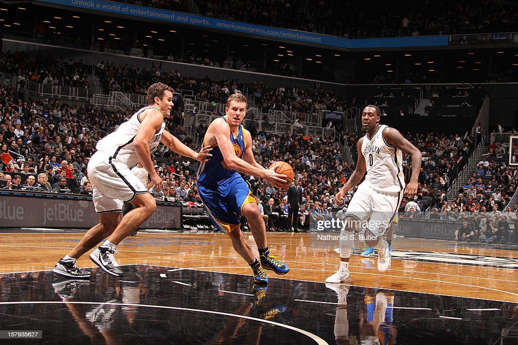 David Lee #10 of the Golden State Warriors drives to the basket against Kris Humphries #43 of the Brooklyn Nets on December 7, 2012 at the Barclays Center in the Brooklyn Borough of New York City.