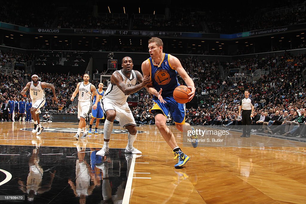 David Lee #10 of the Golden State Warriors drives to the basket against <a gi-track='captionPersonalityLinkClicked' href=/galleries/search?phrase=Andray+Blatche&family=editorial&specificpeople=4282797 ng-click='$event.stopPropagation()'>Andray Blatche</a> #0 of the Brooklyn Nets on December 7, 2012 at the Barclays Center in the Brooklyn Borough of New York City.