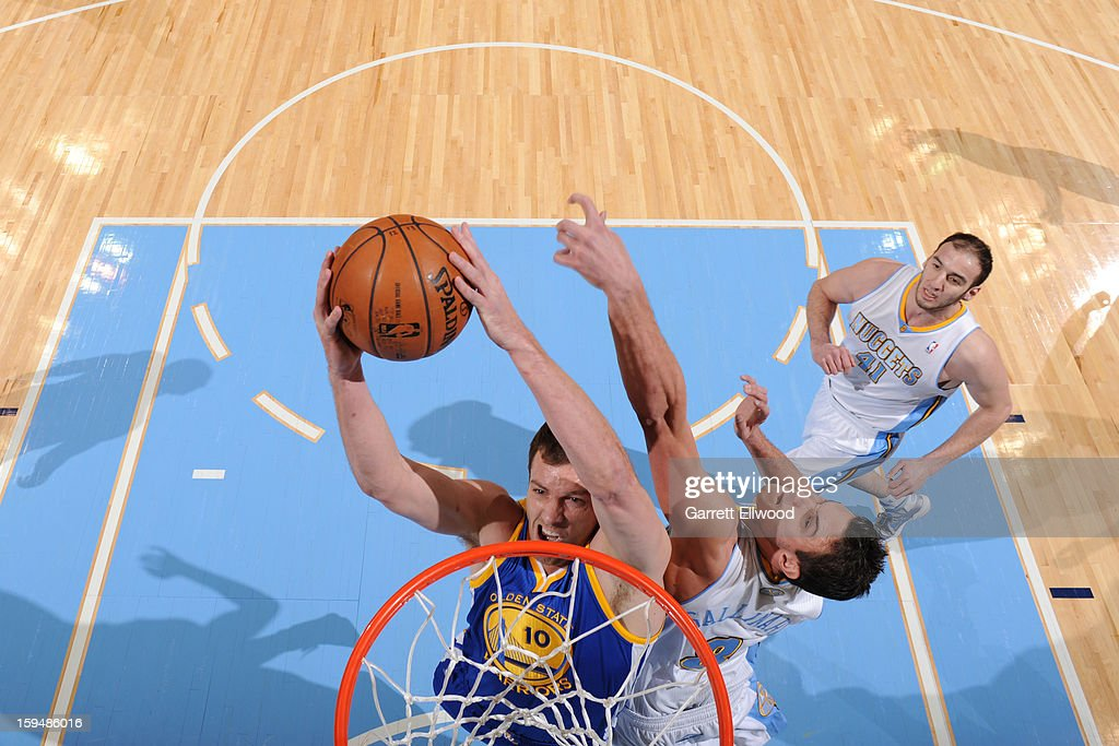 David Lee #10 of the Golden State Warriors drives to the basket against <a gi-track='captionPersonalityLinkClicked' href=/galleries/search?phrase=Danilo+Gallinari&family=editorial&specificpeople=4644476 ng-click='$event.stopPropagation()'>Danilo Gallinari</a> #8 of the Denver Nuggets on January 13, 2013 at the Pepsi Center in Denver, Colorado.