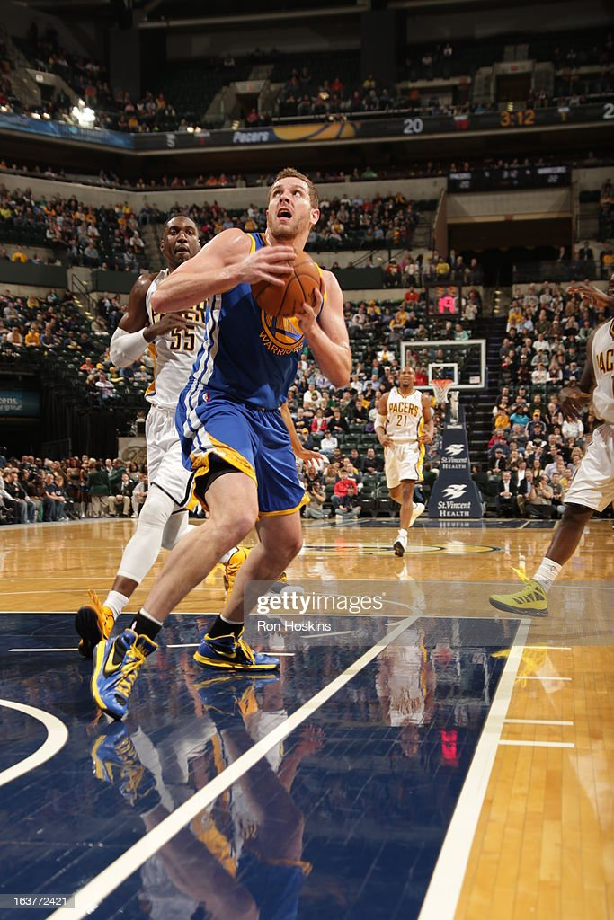 David Lee #10 of the Golden State Warriors drives to the basket against the Indiana Pacers on February 26, 2013 at Bankers Life Fieldhouse in Indianapolis, Indiana.