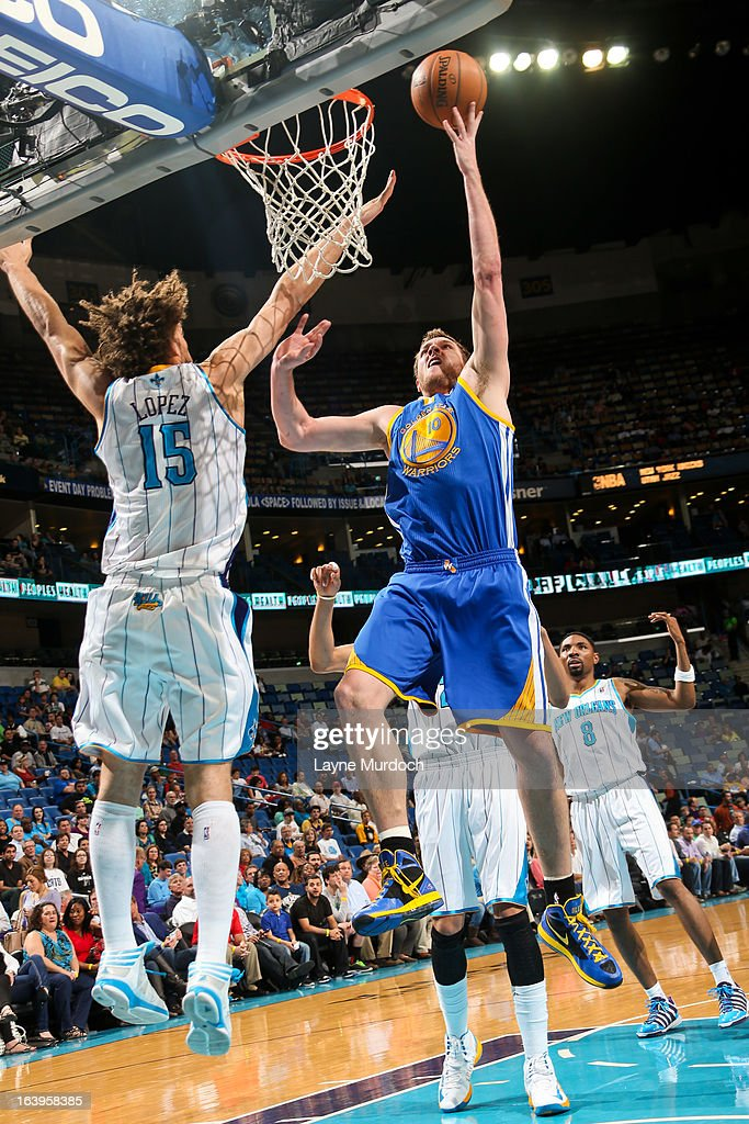David Lee #10 of the Golden State Warriors drives to the basket against Robin Lopez #15 of the New Orleans Hornets on March 18, 2013 at the New Orleans Arena in New Orleans, Louisiana.