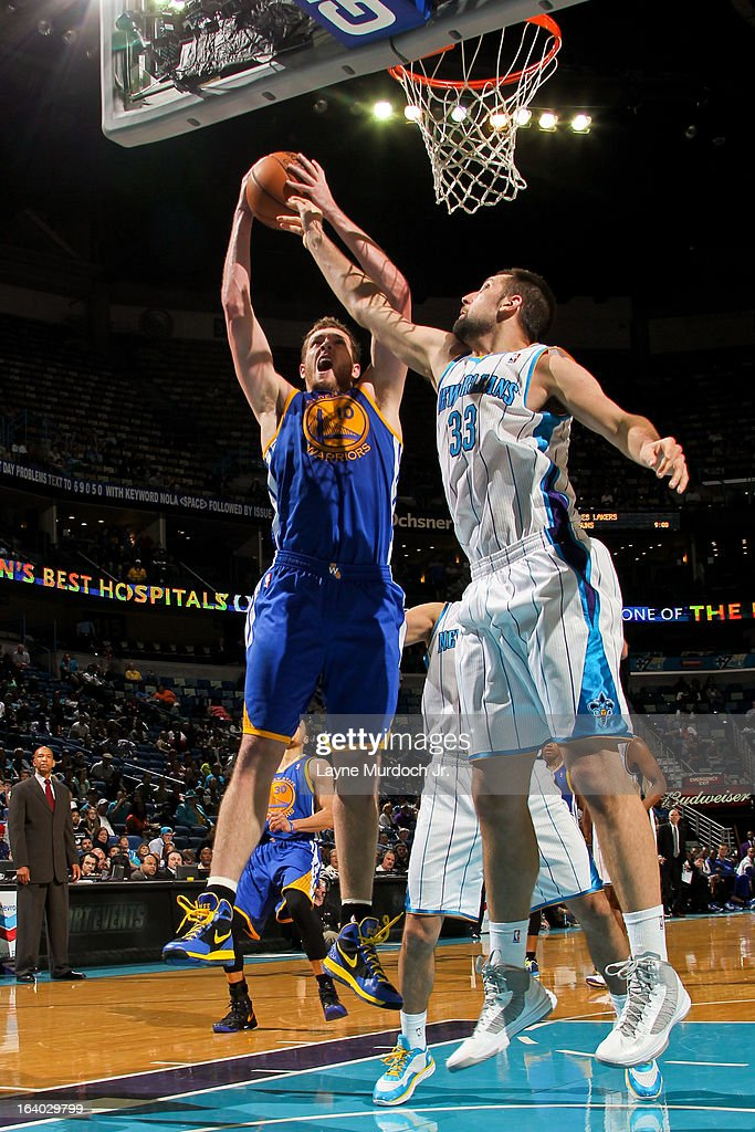 David Lee #10 of the Golden State Warriors drives to the basket against Ryan Anderson #33 of the New Orleans Hornets on March 18, 2013 at the New Orleans Arena in New Orleans, Louisiana.