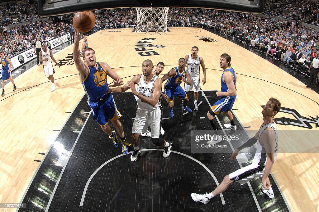 David Lee #10 of the Golden State Warriors drives to the basket against the San Antonio Spurs on March 20, 2013 at the AT&T Center in San Antonio, Texas.