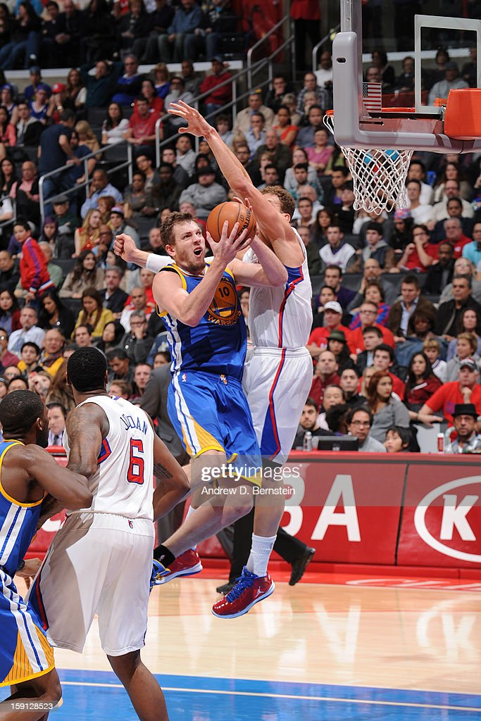 David Lee #10 of the Golden State Warriors drives to the basket around <a gi-track='captionPersonalityLinkClicked' href=/galleries/search?phrase=Blake+Griffin+-+Basketball+Player&family=editorial&specificpeople=4216010 ng-click='$event.stopPropagation()'>Blake Griffin</a> #32 of the Los Angeles Clippers at Staples Center on January 5, 2013 in Los Angeles, California.