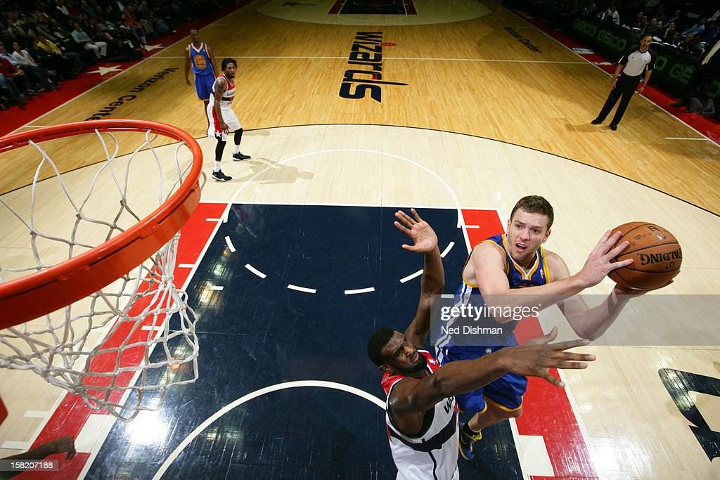 David Lee #10 of the Golden State Warriors drives to the basket <a gi-track='captionPersonalityLinkClicked' href=/galleries/search?phrase=Chris+Singleton&family=editorial&specificpeople=241555 ng-click='$event.stopPropagation()'>Chris Singleton</a> #31 of the Washington Wizards on December 8, 2012 at the Verizon Center in Washington, DC.