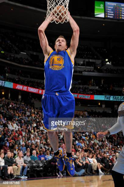David Lee of the Golden State Warriors dunks against the Denver Nuggets on December 23 2013 at the Pepsi Center in Denver Colorado NOTE TO USER User...