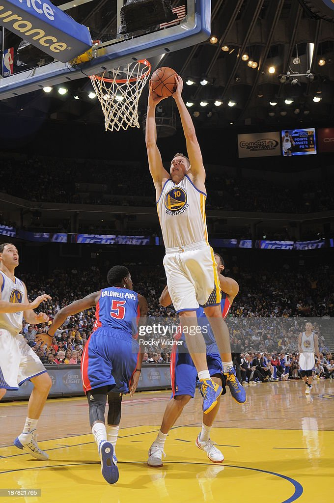 David Lee #10 of the Golden State Warriors dunks against the Detroit Pistons on November 12, 2013 at Oracle Arena in Oakland, California.