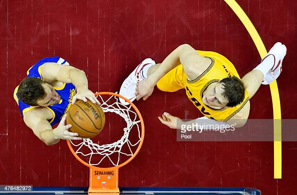 David Lee of the Golden State Warriors dunks against Timofey Mozgov of the Cleveland Cavaliers in the first half during Game Three of the 2015 NBA...