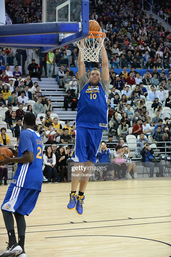 David Lee of the Golden State Warriors dunks during Fan Appreciation Day as part of the 2013 Global Games on October 17, 2013 at the Oriental Sports Center in Shanghai, China.