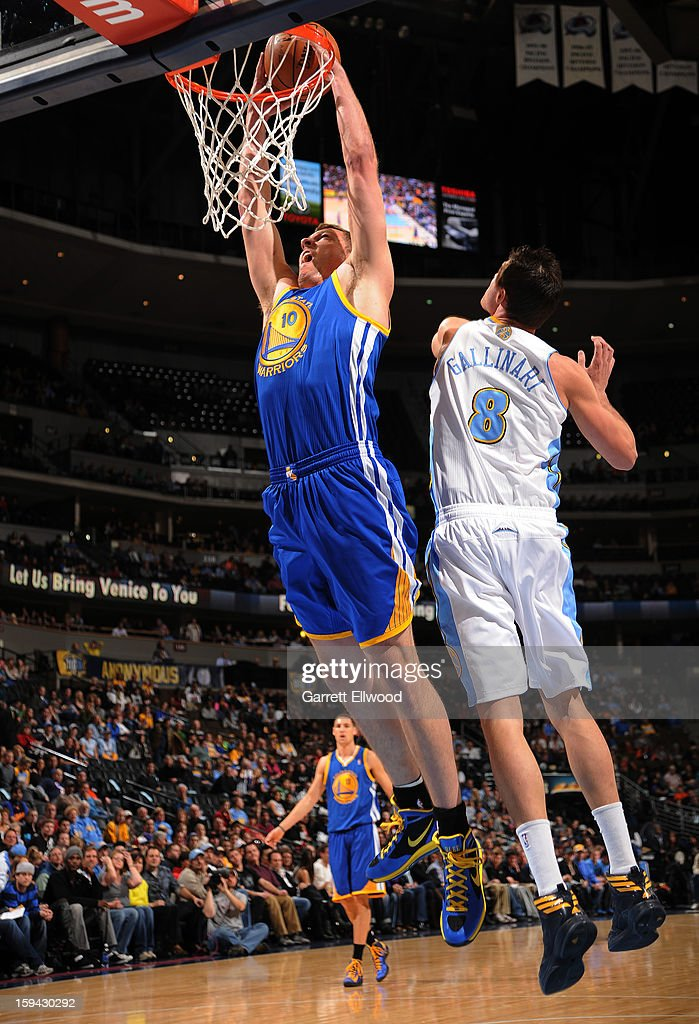 David Lee #10 of the Golden State Warriors dunks the ball against Danilo Gallinari #8 of the Denver Nuggets on January 13, 2013 at the Pepsi Center in Denver, Colorado.