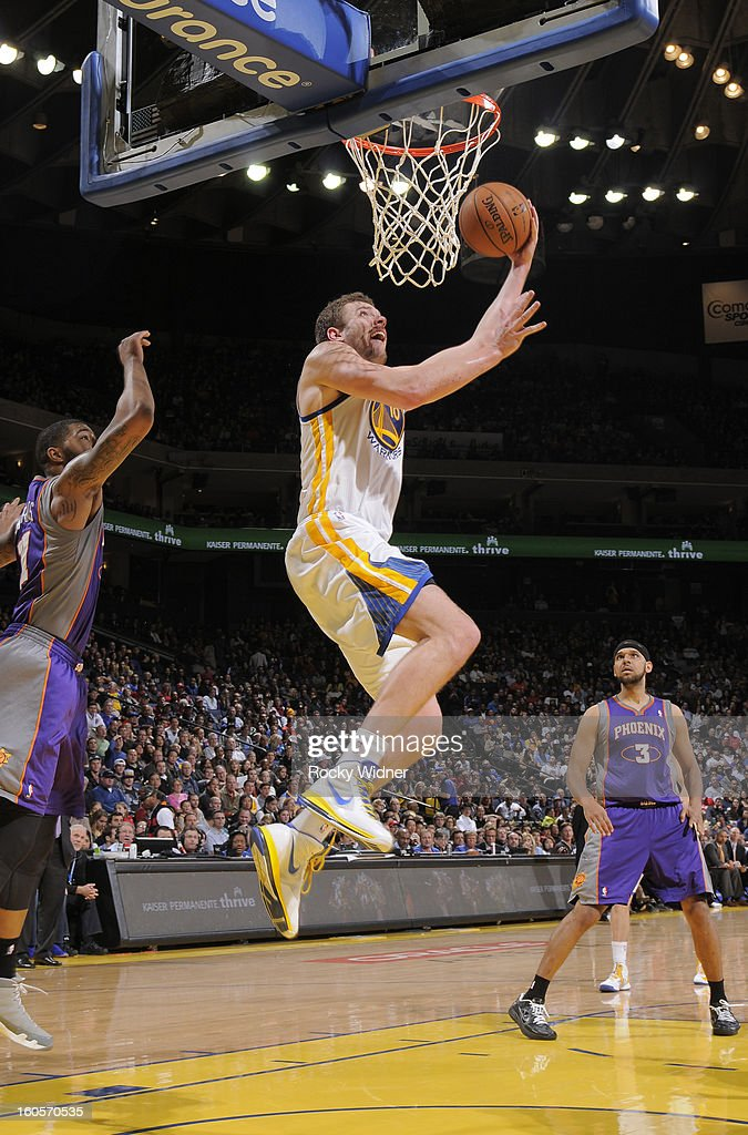 David Lee #10 of the Golden State Warriors goes to the basket against the Phoenix Suns on February 2, 2013 at Oracle Arena in Oakland, California.