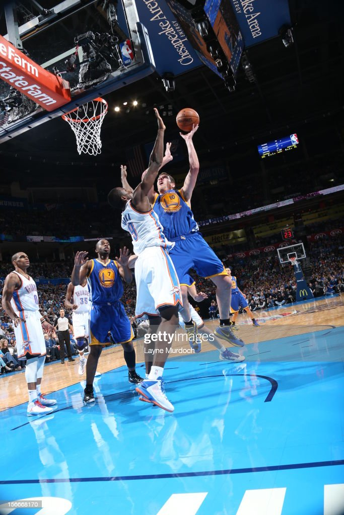 David Lee #10 of the Golden State Warriors goes to the basket during the game between the Oklahoma City Thunder and the Golden State Warriors on November 18, 2012 at the Chesapeake Energy Arena in Oklahoma City, Oklahoma.