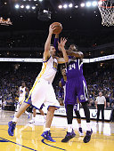 David Lee of the Golden State Warriors goes up for a shot against Jason Thompson of the Sacramento Kings at ORACLE Arena on December 22 2014 in...