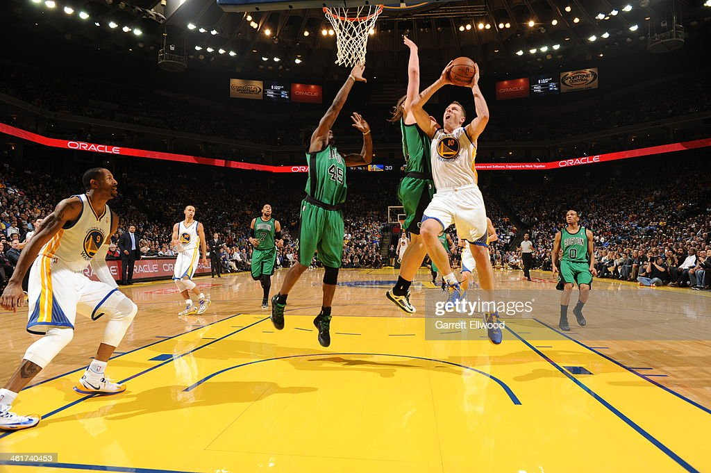 David Lee #10 of the Golden State Warriors goes up for the shot against <a gi-track='captionPersonalityLinkClicked' href=/galleries/search?phrase=Kelly+Olynyk&family=editorial&specificpeople=5953512 ng-click='$event.stopPropagation()'>Kelly Olynyk</a> #41 of the Boston Celtics on January 10, 2014 at Oracle Arena in Oakland, California.