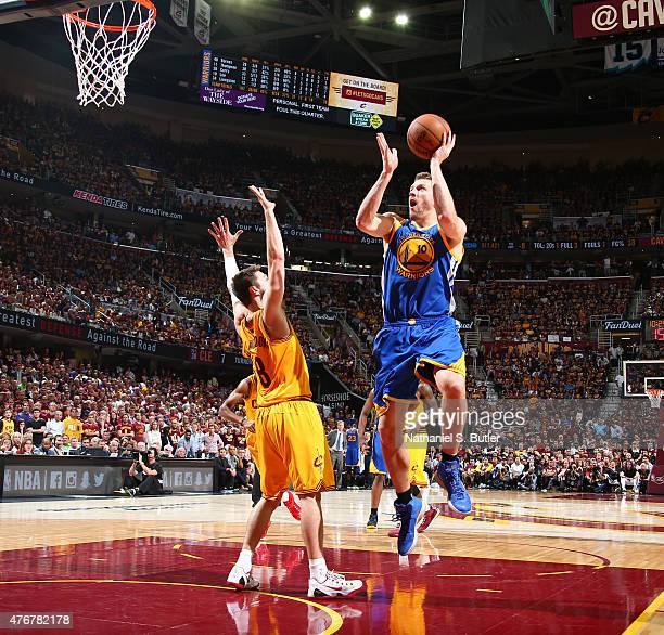 David Lee of the Golden State Warriors goes up to shoot against Matthew Dellavedova of the Cleveland Cavaliers during Game Four of the 2015 NBA...