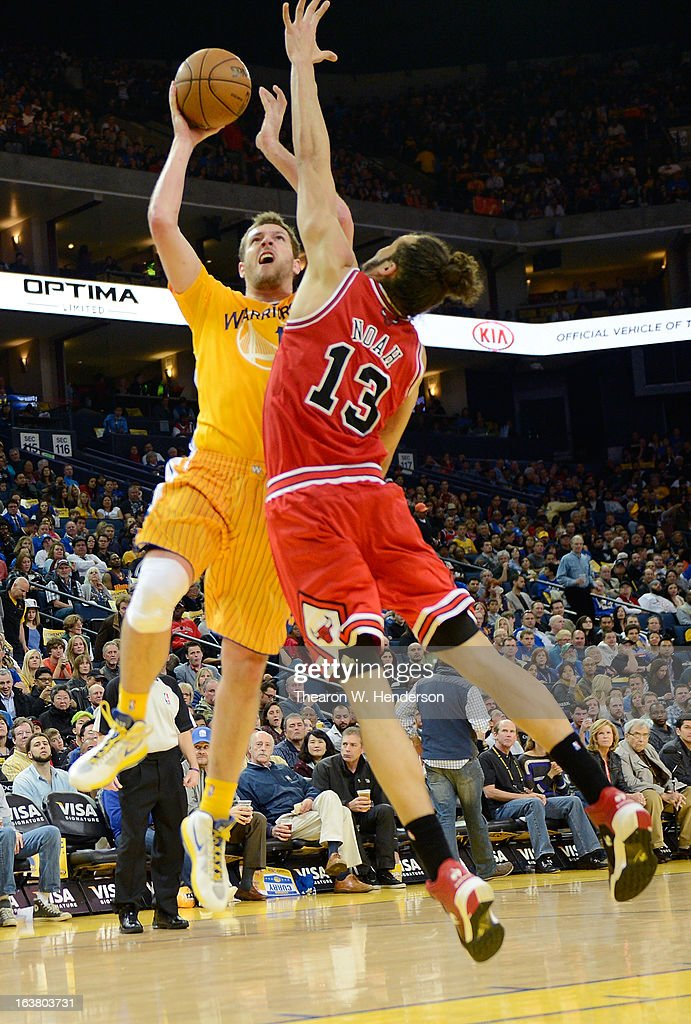 David Lee #10 of the Golden State Warriors goes up to shoot over Joakim Noah #13 of the Chicago Bulls at Oracle Arena on March 15, 2013 in Oakland, California.